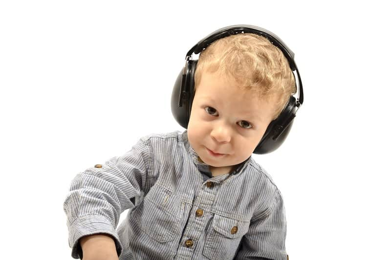 Boy wearing ear defenders
